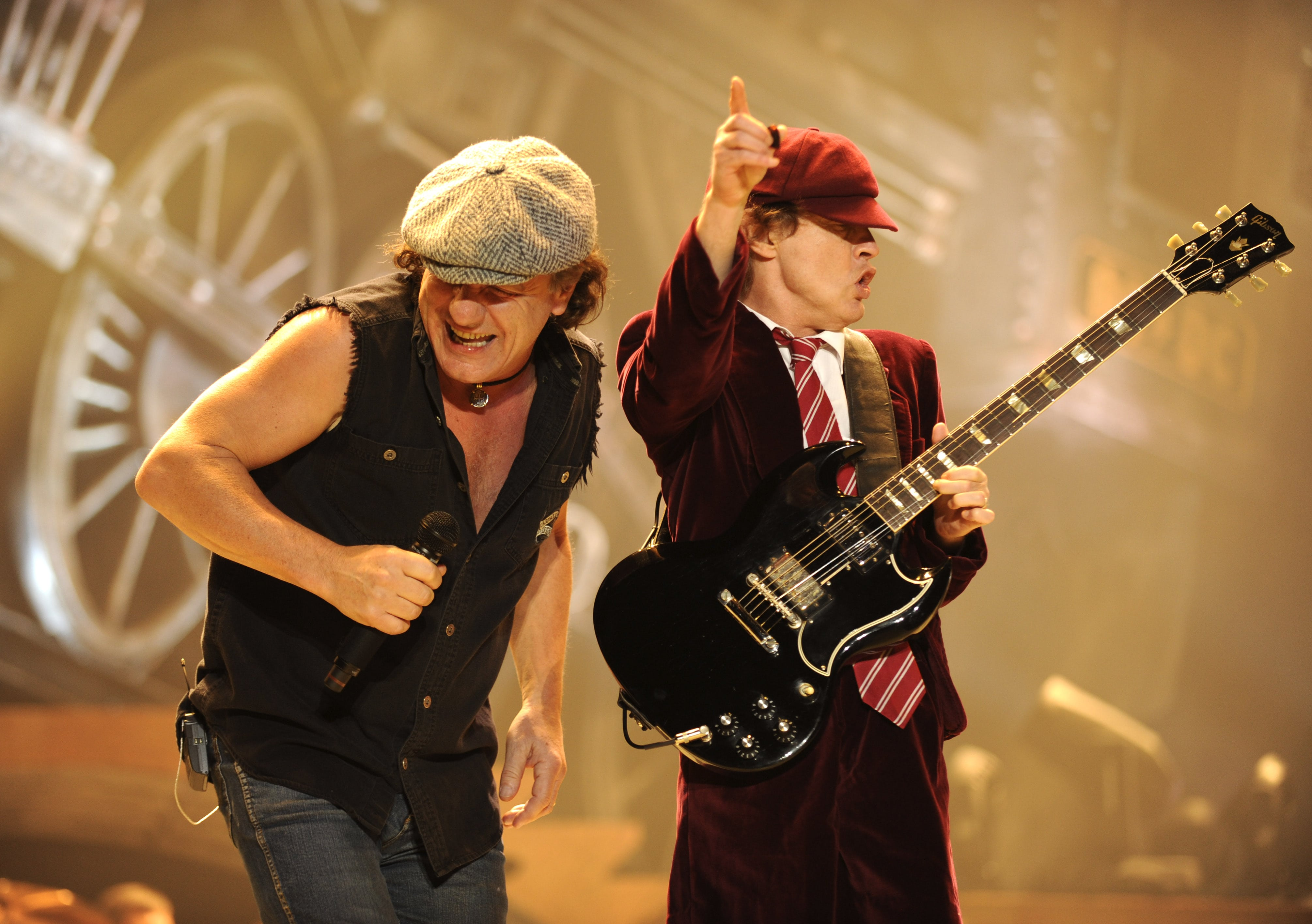 WILKES-BARRE, PN - OCTOBER 28:  Malcolm Young (L) and Angus Young of AC/DC perform during their